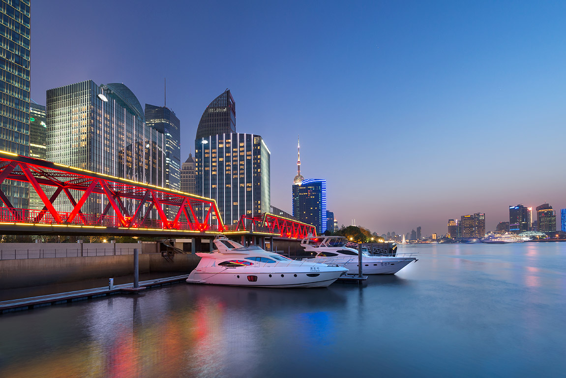 Red bridge at a marina on the Shanghai Huangpu River