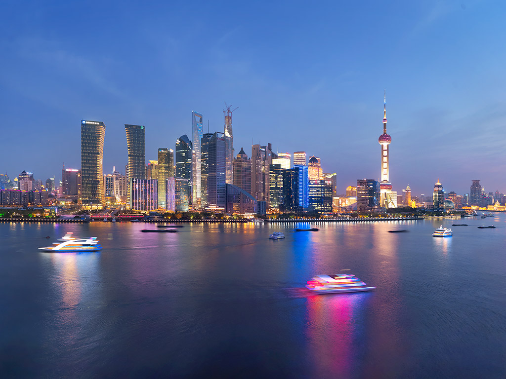 Views of the Mandarin Oriental Hotel across the Shanghai Huangpu River and to The Bund.