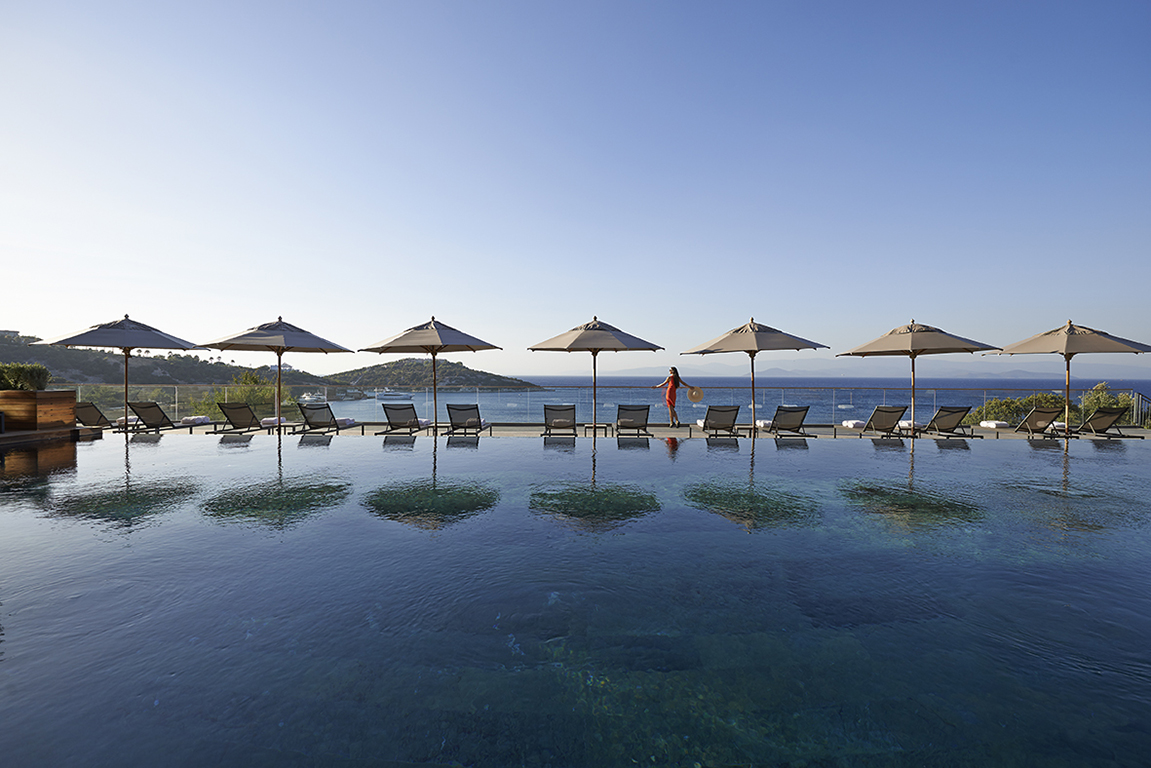Guest enjoying the secluded Mandarin Oriental Bodrum resort in Cennet Koyu (Paradise Bay) on the Bodrum Peninsula where the Mediterranean Sea meets the Aegean Sea.