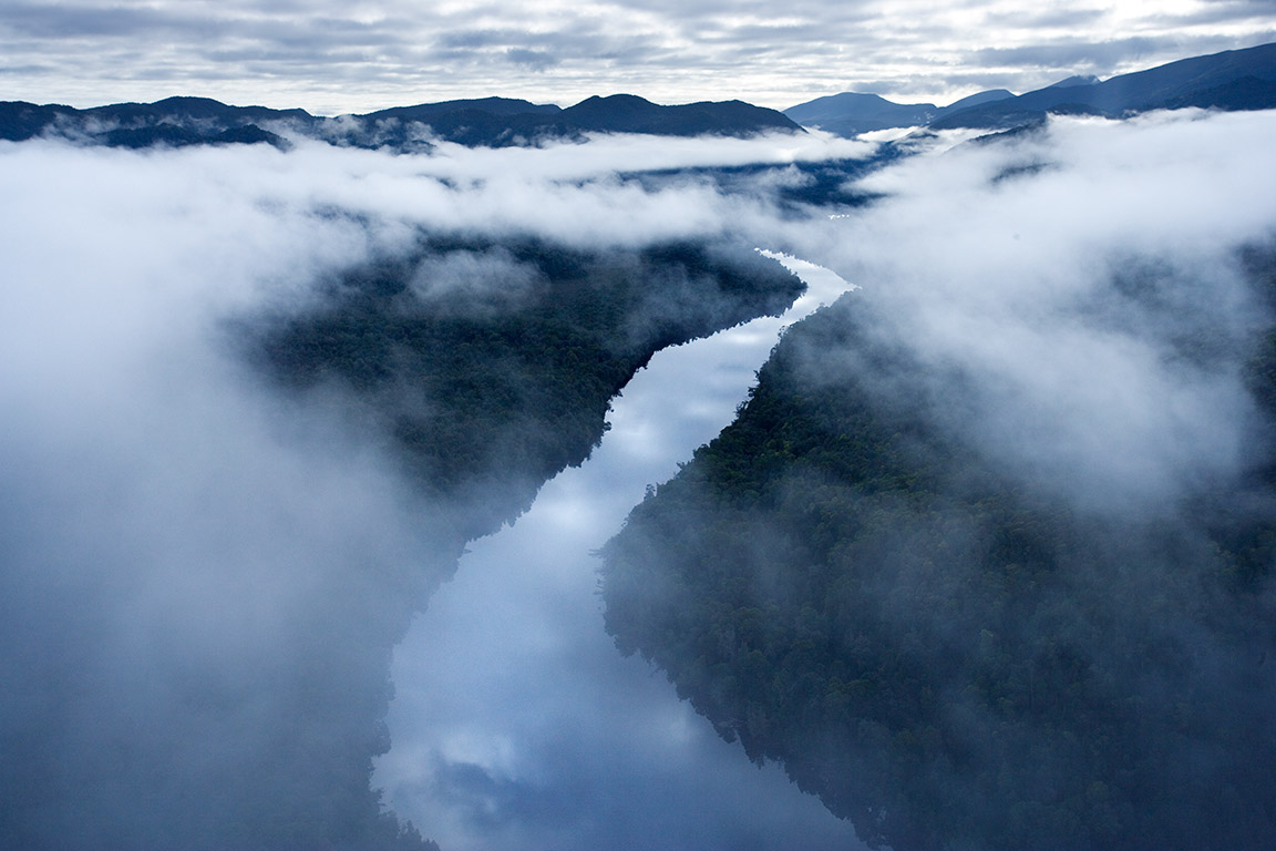 Morning mist over the  Gordon River in the Tasmanian wilderness, Australia