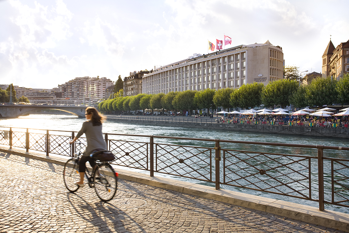 Cycling in summer light, Rhone River Geneva